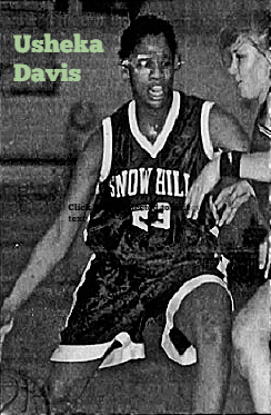 Image of girls basketball player, Usheka Davis, in her Snow ///hill High School (Maryland)attempting to dribble the ball past defender. From The Daily Times, Salisbury, Maryland, April 6, 1997. 'Photos by Joey Gardner and Autumn Winterbottom.'