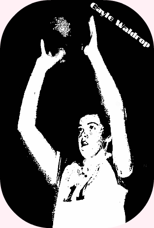 Image of Gayle Waldrop in �-view holding ball over head looking to pass to our left, in uniform number 11. From The Gastonia Gazette, Gastonia, North Carolina, January 25, 1955.