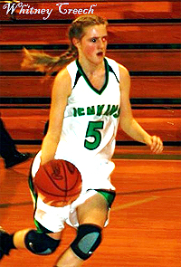 Whitney Creech, Jenkins High (Kentucky) number 5, dribbling the ball upcourt (to the right).