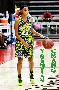 Yasmeen Chang, Riverdale frosh basketball player, in a Futures green camouflage uniform, number 23, dribbling.