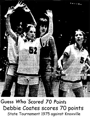 Picture of Deb Coates, Mediapolis forward, scoring 70 points in a March, 1975 State Basketball Tournament game against Knoxville; she is being guarded by three players, Pam Marsh, Joanie Stickle, and Karen Rowley.