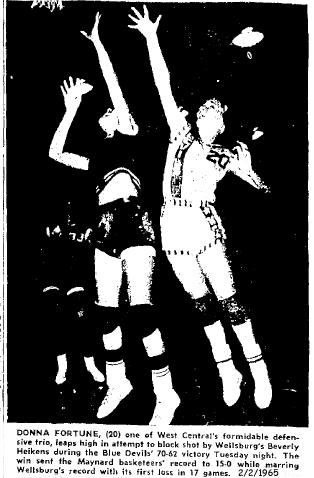 Donna Fortune, West Central High jumping to attempt block of Wellsburg's Beverly Heikens, in an Iowa 6-on-6 basketball game on February 2, 1965; the Blue Devils of Maynard won 70 to 62 to make their record 15-0, it was Wellsburg's first loss in 17 games. Oelwein Daily Register, 2/2/1965.