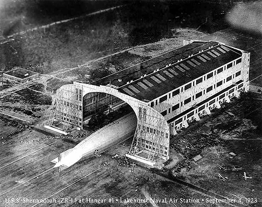 Aerial photo, circa 1924, is the U.S/. Navy rigid airship Shenandoah (ZR-1), halfway into historic Hanger One. It is halfway in, we see the tail.