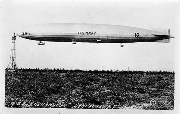 Side view of USN Shenandoah, US Navy rigid airship, at mooring mast