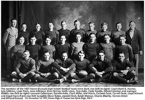 Team photo of the 1927 Haven High football team from Kansas, who had a 256 to nothing victory over Sylvia High, on November 16, 1927. The caption reads: The members of the 1927 Haven (Kansas) High School football team were: Back Row (left to right): Coach Buell K. Hunter, Lyle Gibbons, Louis Koch, Jesse Atkinson, Elvin McCoy, Keith Lowe, Tom Astle, Clyde Seedle, Alfred Coleman and manager  Middle Row (left to right): Leonard Culbertson, Darwin Astle, Clark Miller, Mel HArris, Corland Cook, CArroll Cook, Lloyd Schrock and Lloyd Harris  Front Row (left to right): Oliver Baker, Arnold Hirsch, Ralph Watson, Charles Blachly, Vernon Meier and Millard Kincaid.