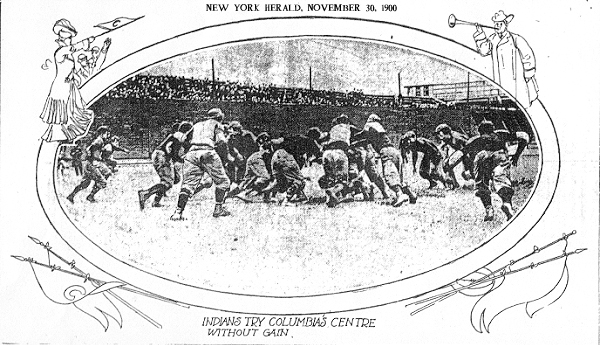 Photograph in an oval frame from the New York Herald, Friday, November 30, 1900; illustrations of fanfare bugel being blown, woman fan with 'C' pennant. Captioned INDIANS TRY COLUMBIA'S CENTRE WITHOUT GAIN. Picture of football being played on Manhattan Field during Columbia versus Carlisle football game.