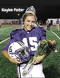 Image of Kaylee Foster, Ocean Springs High (Mississippi), placekicker and homecoming queen, posing in uniform (#15) wearing crown, on field with helmet and bouquet.