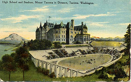 Old postcard of High School and Stadium, Mount Tacoma in Distance, Tacoma, Washington. Tacoma High School was renamed Stadium High School in 1913, after the Stadium Bowl built in 1910. The Federal Government calls the distant mountain Mount Ranier, not Mount Tacoma.