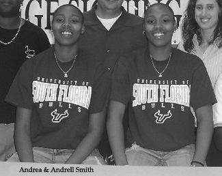 Andrea and Andrell Smith, identical twin basketball players for the Lake Gibson Braves of Lakewood and the AAU Comets Fusion team from Florida, after their signing with the university of South Florida for 2006-09.