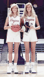 Heidi (l.), and Heather Burge (r.), University of Virginia basketball players and identical twins, standing in front of basket.