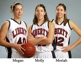 Photo of Liberty University basketball players, the Frazee triplets, 6-foot 3-inch Megan, number 40, 6-foot 2-inch Molly, number 41 and 6-foot 3-inch Moriah, number 42, juniors
