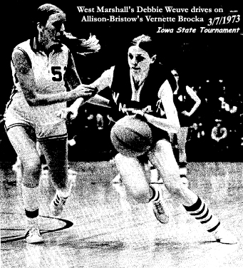 West Marshall's Debbie Weuve driving on Allison-Bristow's Vernette Brocka in a 6-on-6 girls basketball State Tournament first round game at the Veteran's War Memorial, on March 7, 1993.