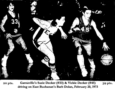 District Playoffs, February 20, 1973, at Oelwein; Garnavillo High School's forwards freshman Vickie Decker, number 45, scored 39 points, sister Susie Decker, number 33, scored 20 points. Here we see them attacking East Buchanan's Barb Dolan in the 69-56 first round victory. Photo credit: Dave Gallup.