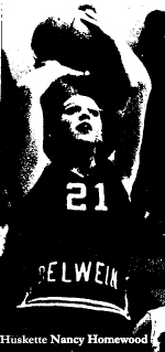 Picture of basketball player Nancy Homewood, in action, shooting for the Oelwein High School Huskettes, scoring 50 points against Cedar Rapids Prairie in a 73-52 win on December 20, 1973. (Iowa 6-on-6)