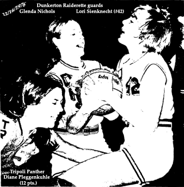 Dunkerton High School Raiderette basketball guards, Glenda Nichols and Lori Sienknecht, number 42, battle for the ball, Tripoli High Panthers' forward Diane Pleggenkuhle at their side, in a December 16, 1976 Iowa 6-aside basketball game. Pleggenkuhle would score 12 points in a 33 to 28 Dunkerton victory. Photo by Scott Little, from the 12/18/1976 Oelwein Daily Register.