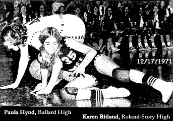 Image of Ballard High's Paula Hynd, and Roland-Story's Karen Ritland, number 35, fallen to the floor, the ball bouncing away, in an Iowa 6-on-6 basketball game, December 17, 1971. Roland won, 66-30.